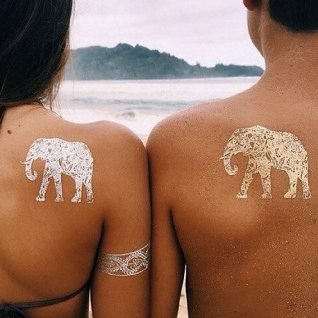 Tatouage dor en couple 24 tatouages dor s pour une peau illumin e elle - Tatouage pour couple ...