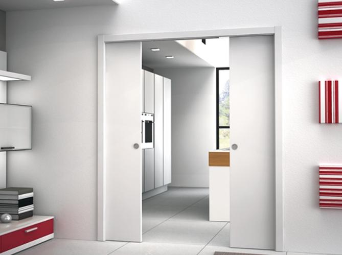 Les portes coulissantes jouent les cloisons avec succ s - Porte coulissante integree dans la cloison ...