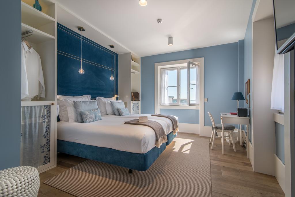 une belle chambre d h tel lisbonne les plus belles chambres d h tel pour une nuit de saint. Black Bedroom Furniture Sets. Home Design Ideas
