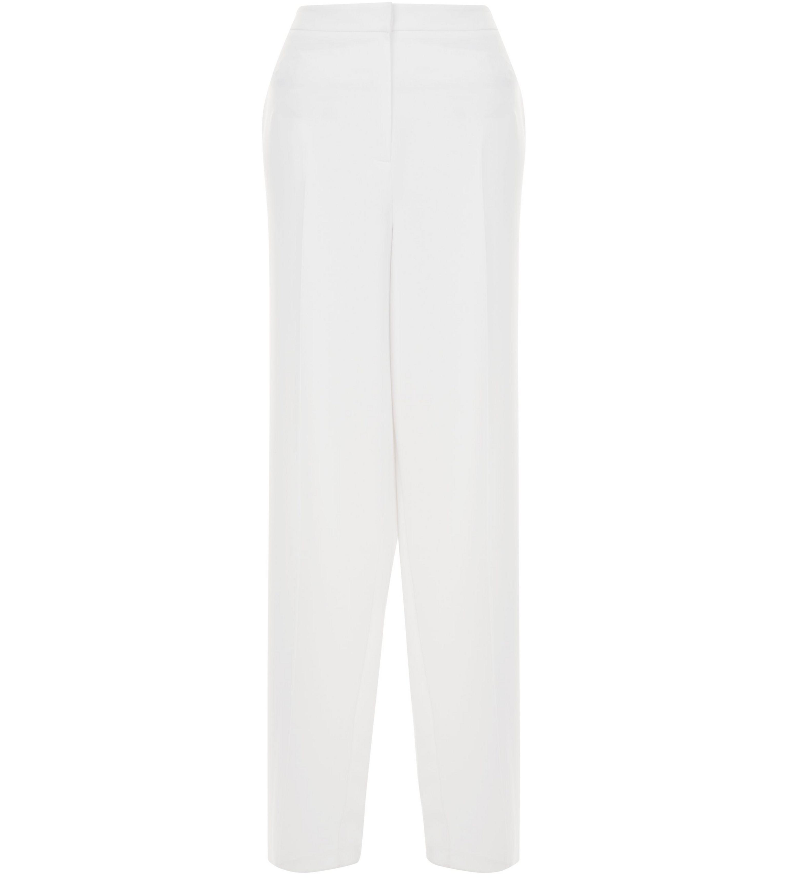 pantalon blanc new look destination seventies elle. Black Bedroom Furniture Sets. Home Design Ideas